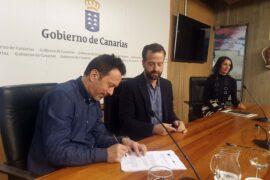 Andermatt y Márquez firmando el convenio